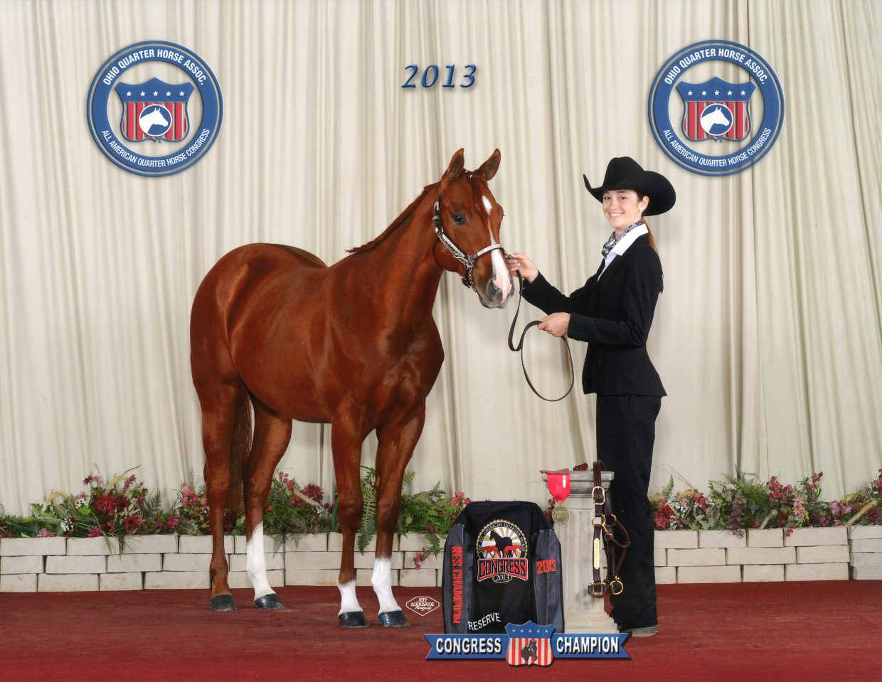 The Suttons donated this mare — RWS Color Me Intrigued — to the Ranching Heritage Young Horse Development Program. She was Reserve Youth Yearling Mare at the 2013 Quarter Horse Congress.