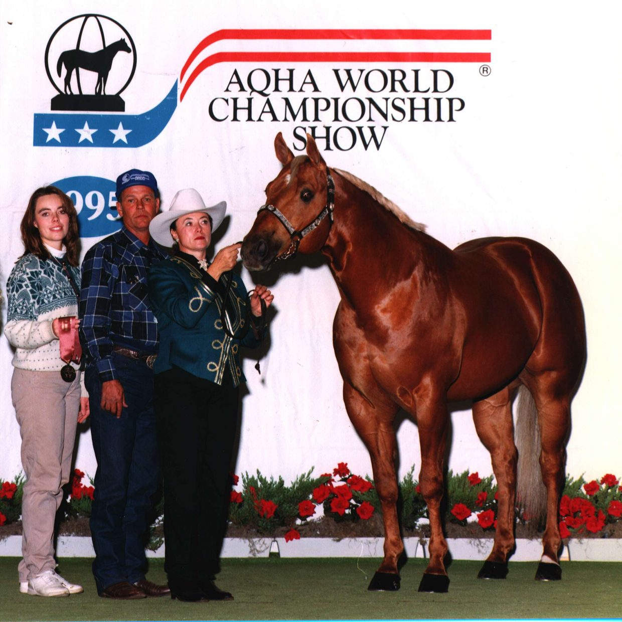 Sutton's Solid Gold Edition was a ranch stallion who achieved fourth in the nation in 1995 aged stallions. Pictured here are Heather, Ray, and Georga at the AQHA World Show